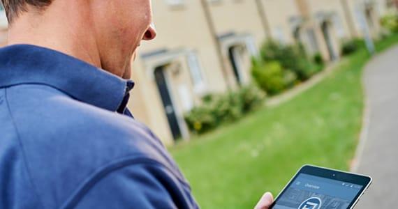 Estate agency board erector using the SignMaster3 board management App.