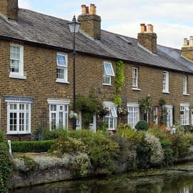 UK property Market - Row of cottages next to a river