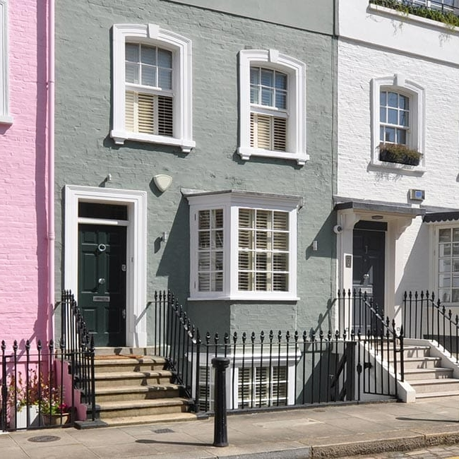 A row of Pastel coloured houses - UK housing market