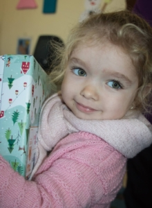 Agency Express Shoebox Appeal 2017 news article image - Girl receiving gifts.