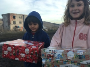 Agency Express Christmas shoebox appeal - Young gir and boy with gift