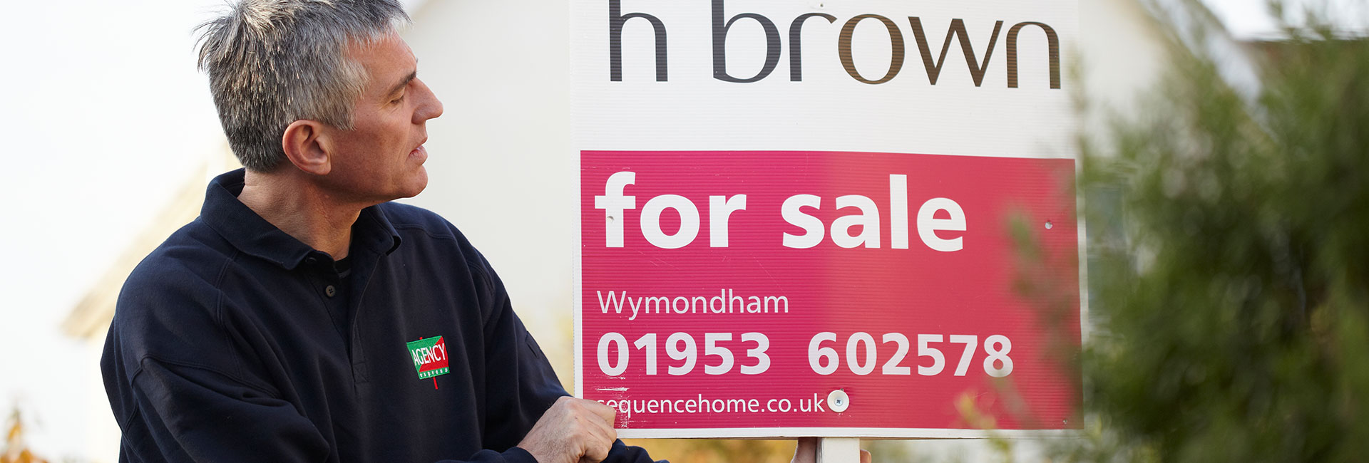 Estate Agency board erector with William H Brown estate agency board. - UK property market