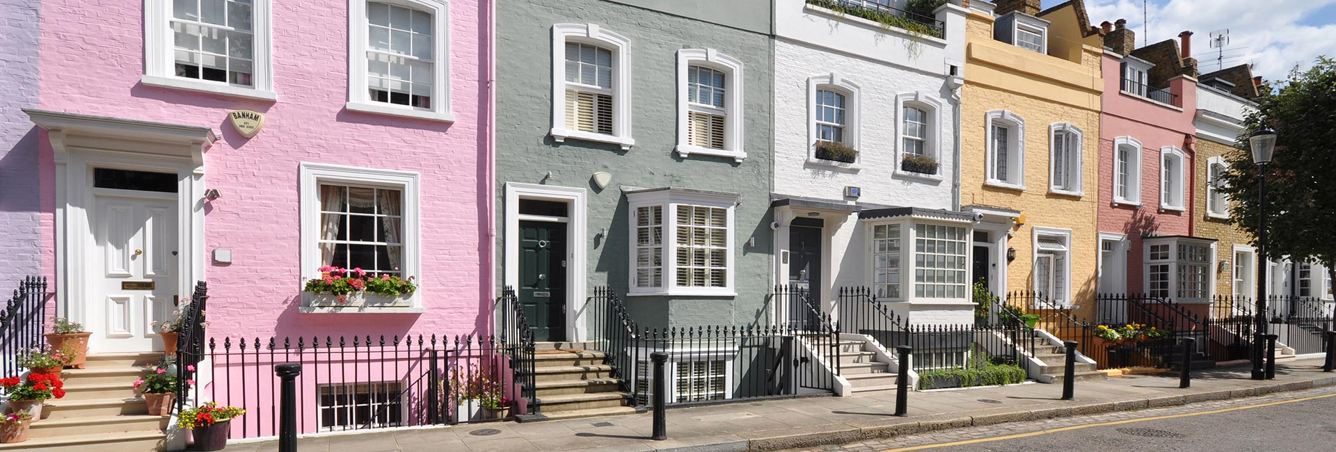 Row of brightly coloured houses. Review on the UK lettings market