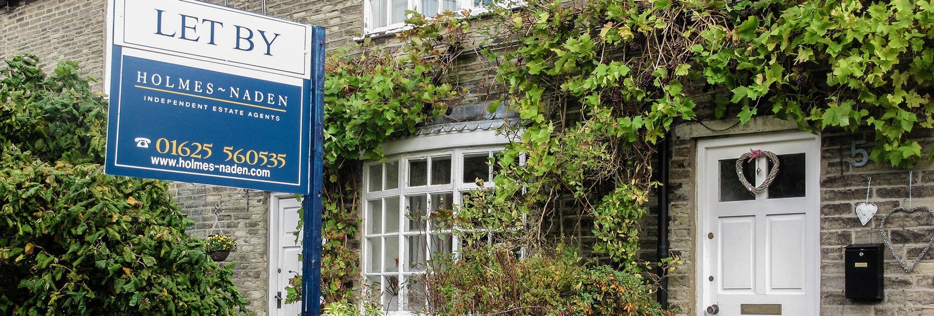 Holmes Naden estate agency board erected outside a cottage - Property Activity Index Report