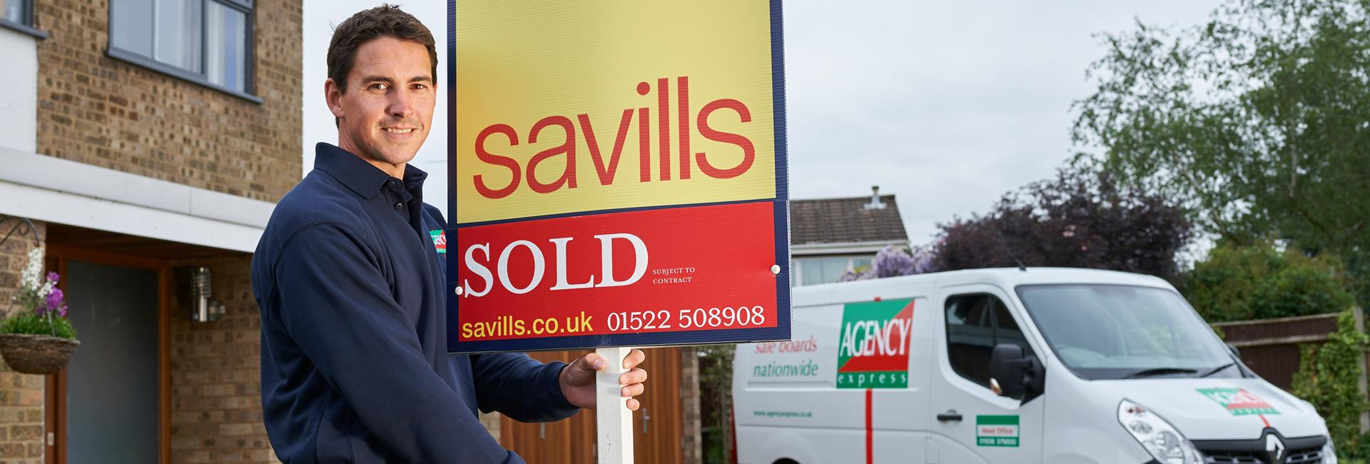 Estate agency sold board - UK property activity