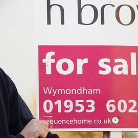 Estate Agency board erector with William H Brown estate agency board. - UK property market